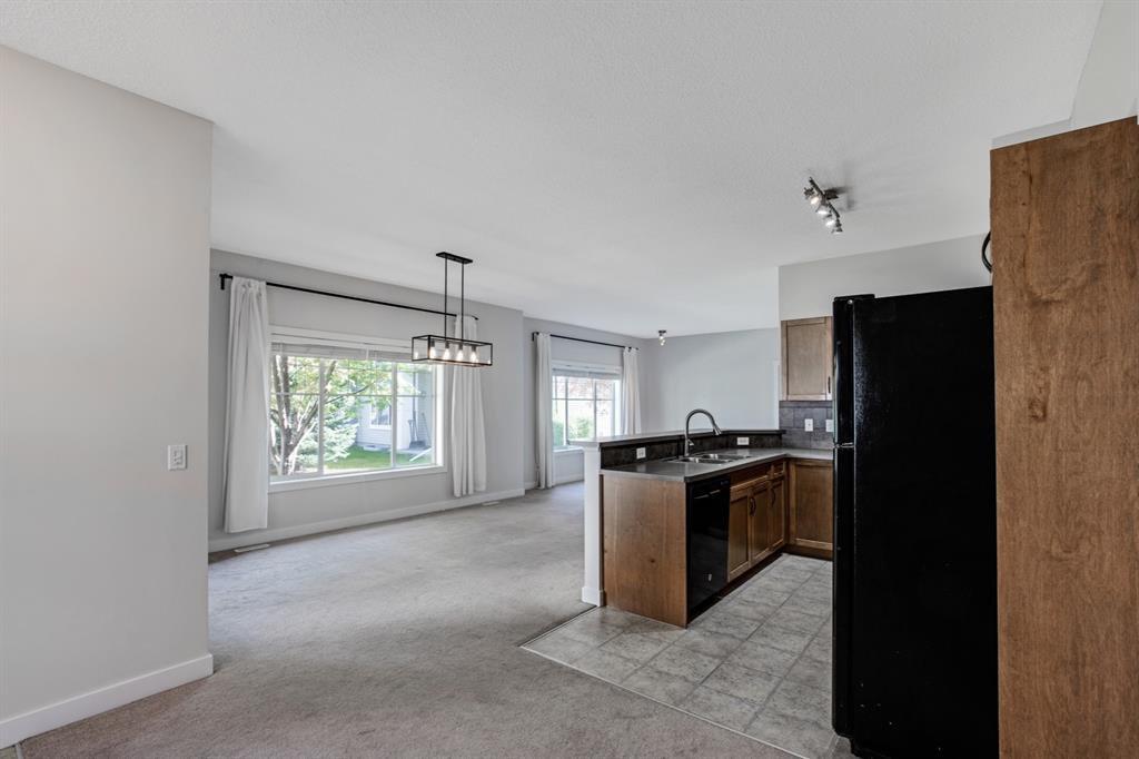 Photo 8: Photos: 1501 281 Cougar Ridge Drive SW in Calgary: Cougar Ridge Row/Townhouse for sale : MLS®# A1040162