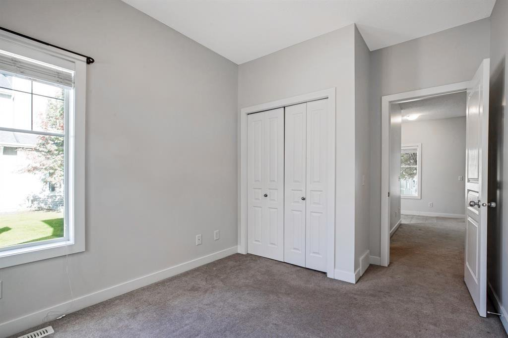 Photo 18: Photos: 1501 281 Cougar Ridge Drive SW in Calgary: Cougar Ridge Row/Townhouse for sale : MLS®# A1040162