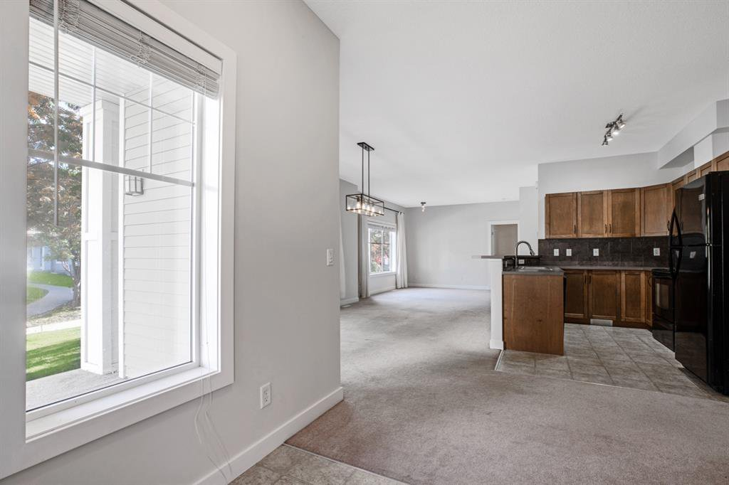 Photo 6: Photos: 1501 281 Cougar Ridge Drive SW in Calgary: Cougar Ridge Row/Townhouse for sale : MLS®# A1040162