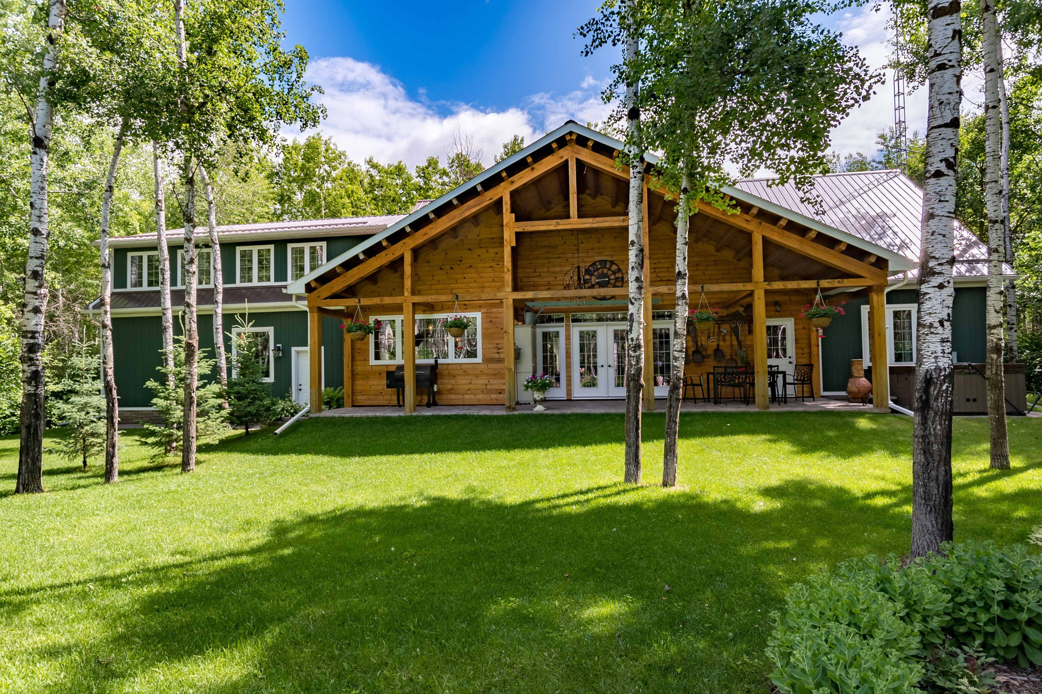 PRIDE OF OWNERSHIP! Meticulously maintained 2500 sf 3 bedroom bungalow (2011), with metal roof, vaulted timber frame covered 40x12 patio, 25x24 AT2, fantastic 40x36 Workshop on a beautifully  landscaped mature treed 5 acre lot.