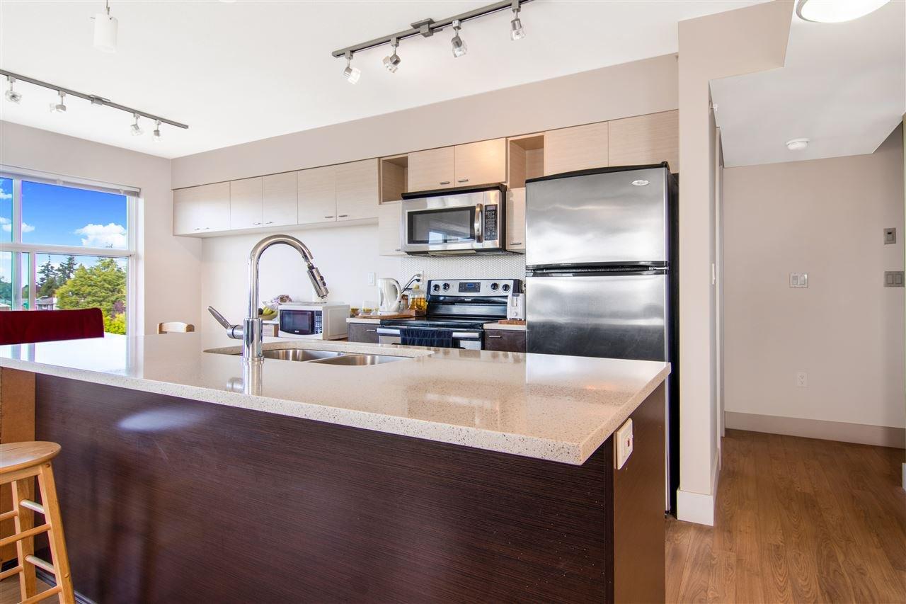 "Main Photo: 404 7445 120 Street in Delta: Scottsdale Condo for sale in ""TREND OF DELTA"" (N. Delta)  : MLS®# R2501411"