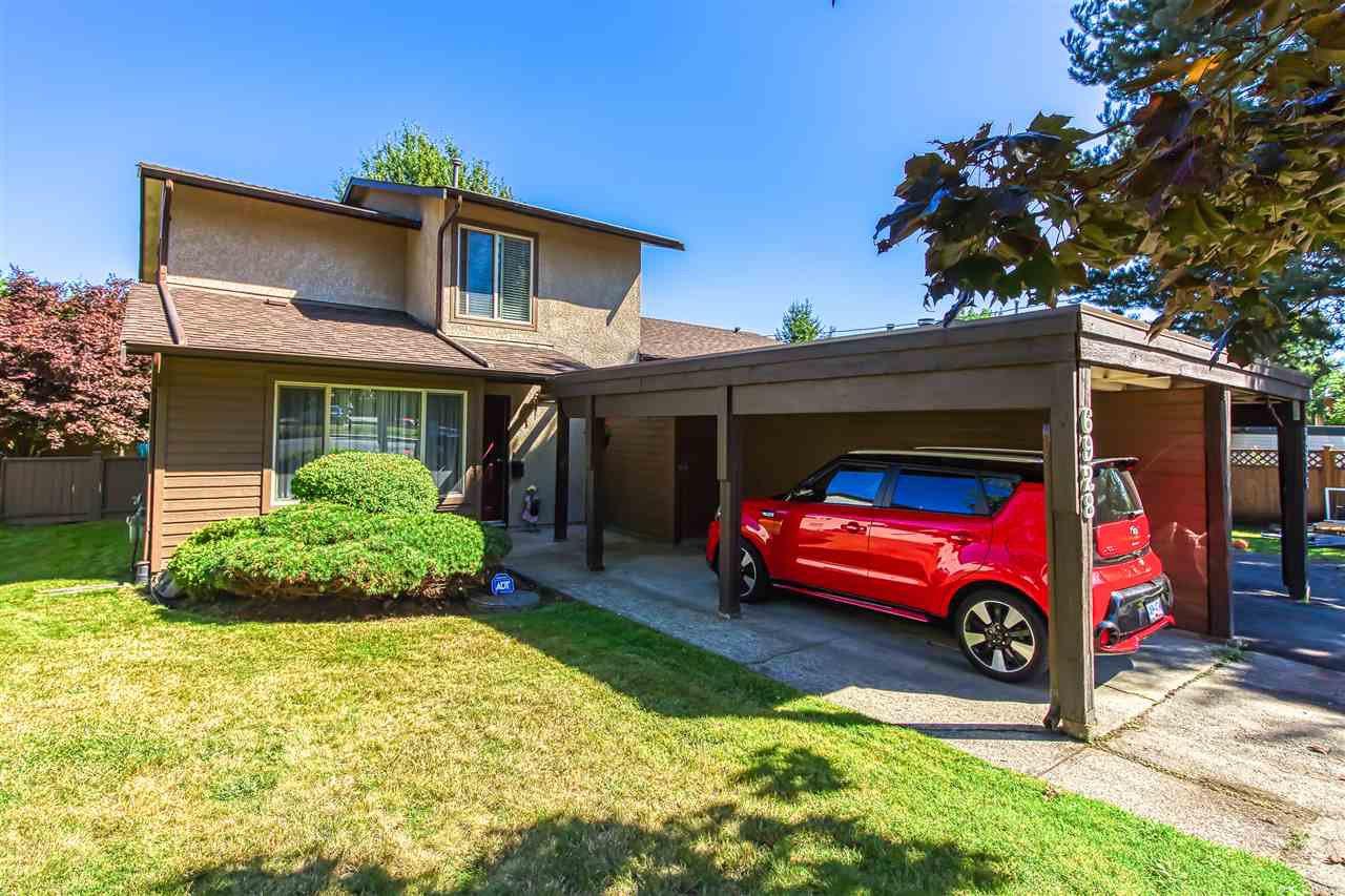 "Main Photo: 6928 134 Street in Surrey: West Newton House 1/2 Duplex for sale in ""BENTLEY"" : MLS®# R2490871"