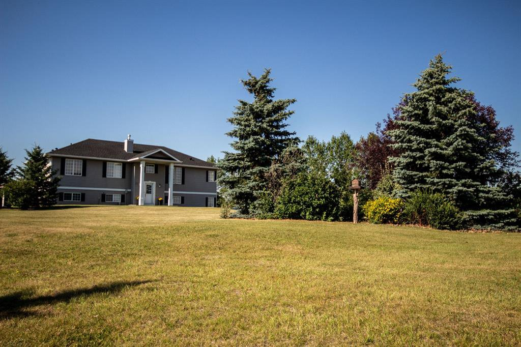 Main Photo: 207 Stage Coach Lane in Rural Rocky View County: Rural Rocky View MD Detached for sale : MLS®# A1039223