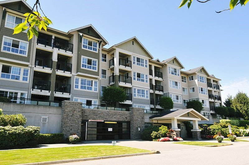 "Main Photo: 316 19673 MEADOW GARDENS Way in Pitt Meadows: North Meadows PI Condo for sale in ""THE FAIRWAYS"" : MLS®# R2400700"