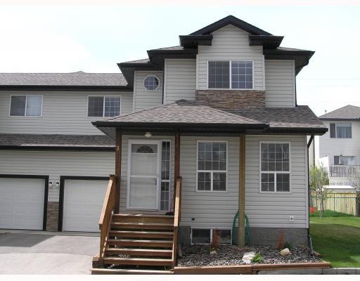 Main Photo: 3 135 BOW RIDGE Drive: Cochrane Townhouse for sale : MLS®# C3389240