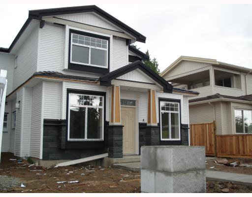 Main Photo: 7152 CANADA Way in Burnaby: Burnaby Lake House 1/2 Duplex for sale (Burnaby South)  : MLS®# V764368