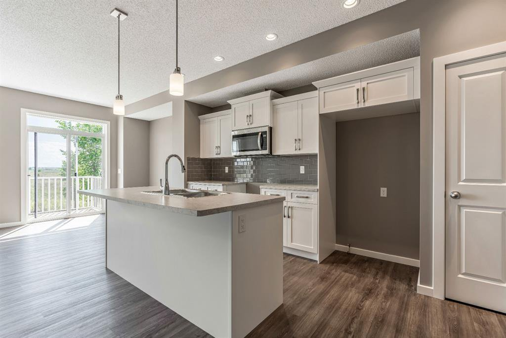 Photo 6: Photos: 16 1407 3 Street SE: High River Row/Townhouse for sale : MLS®# A1038132