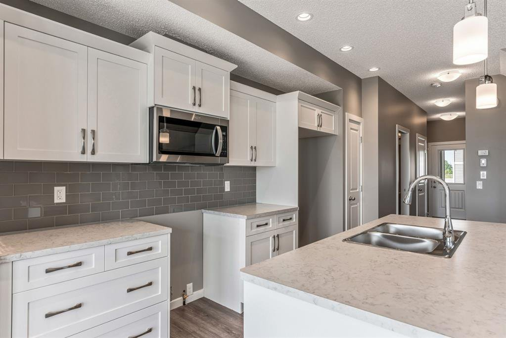 Photo 9: Photos: 16 1407 3 Street SE: High River Row/Townhouse for sale : MLS®# A1038132