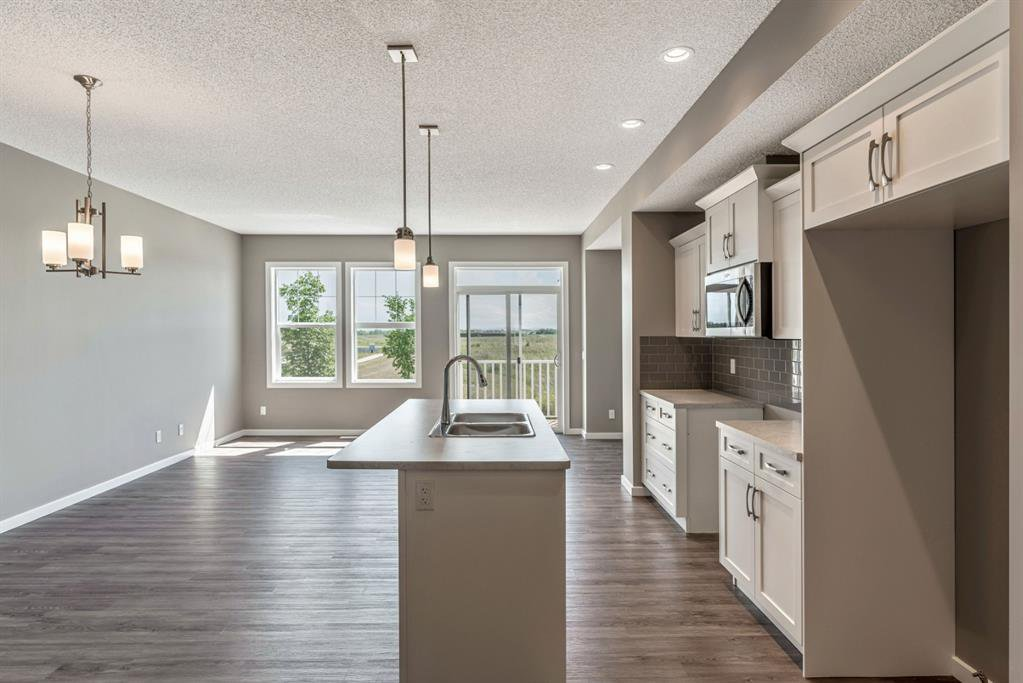 Photo 5: Photos: 16 1407 3 Street SE: High River Row/Townhouse for sale : MLS®# A1038132