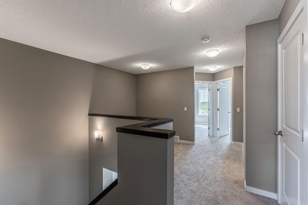 Photo 10: Photos: 16 1407 3 Street SE: High River Row/Townhouse for sale : MLS®# A1038132