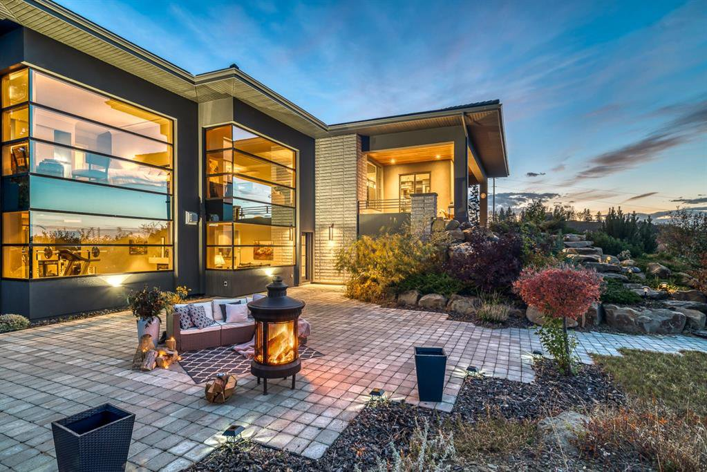 Presenting an architectural masterpiece perched on a gorgeous hillside and overlooking the valley, mountains, and city scapes.