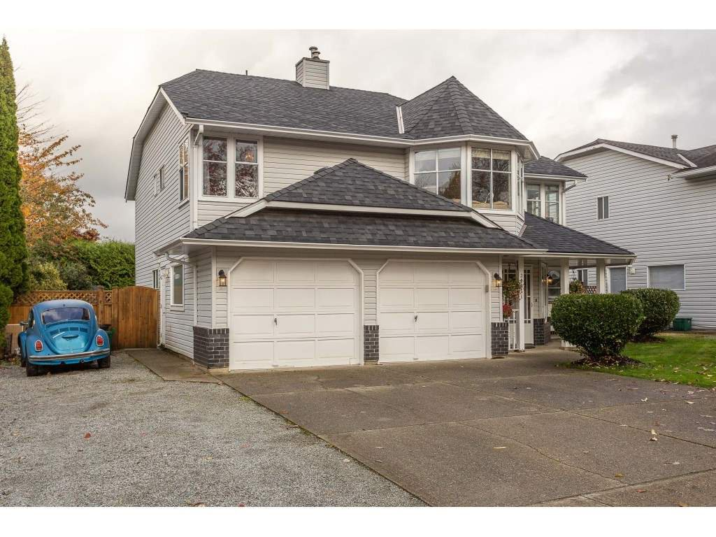 A well-maintained, charming home with level driveway and extra parking for guests, RV's and toys.