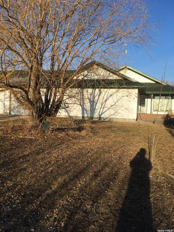This one of a kind property is listed below assessment value. Just under 5 acres, approx. 5300 sq ft shop, oversized heated triple garage, 2,209 sq ft house, 40 kg from Regina, 10 min from Southey.