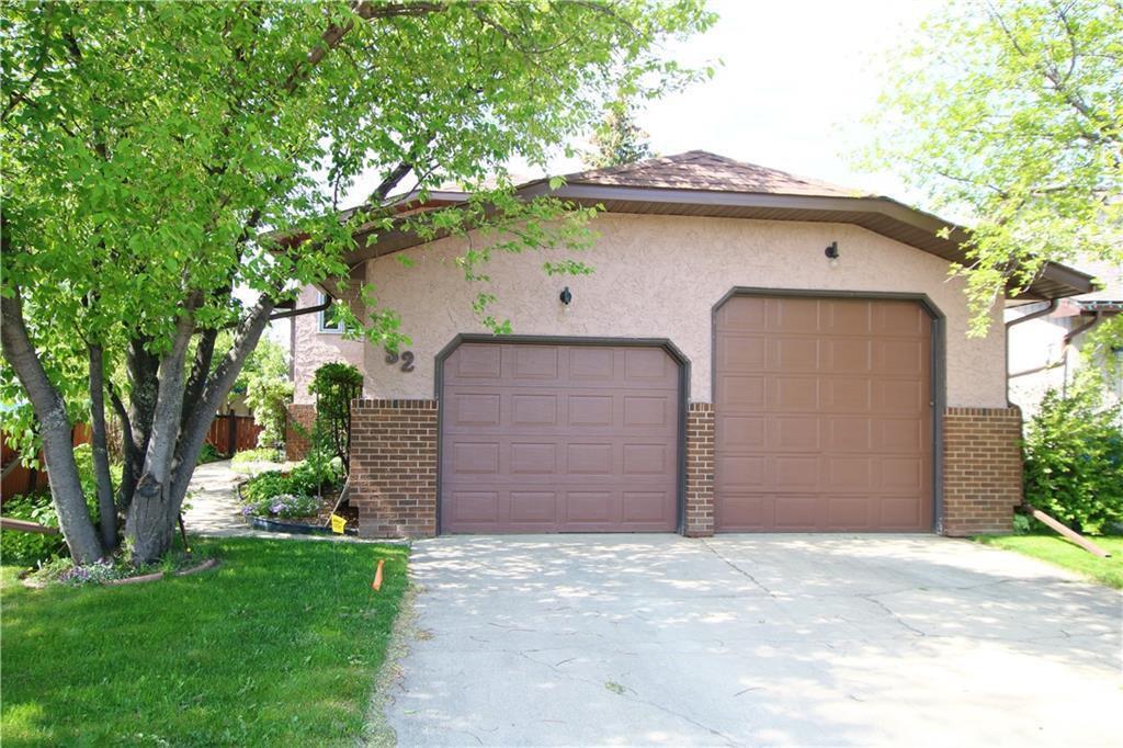 Welcome to 52 Big Springs Green. 24' x24' double attached garage with 1- 7' door & 1- 9' door