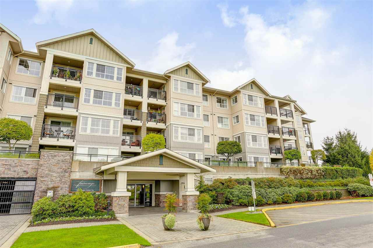 "Main Photo: 322 19673 MEADOW GARDENS Way in Pitt Meadows: North Meadows PI Condo for sale in ""THE FAIRWAYS"" : MLS®# R2116868"