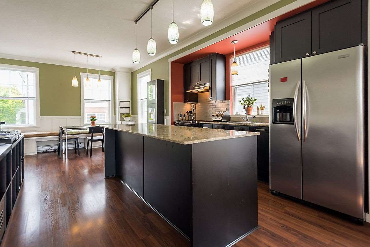 You will love entertaining with this chef's kitchen.  Note the island has an eating bar for easy meals too.  Stainless Steel appliances, window over the sink & supplementary storage make this your dream kitchen.