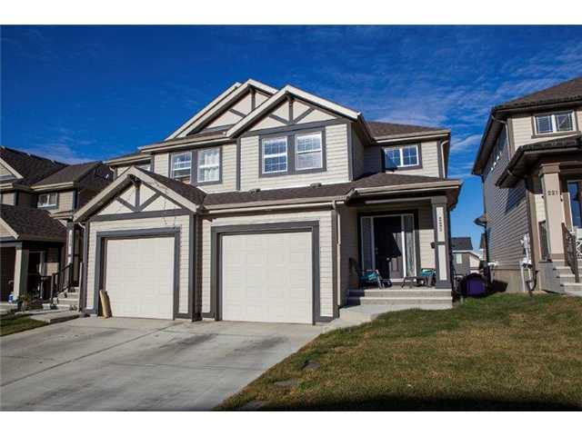 Main Photo: 225 SUNSET Common: Cochrane Residential Attached for sale : MLS®# C3590396