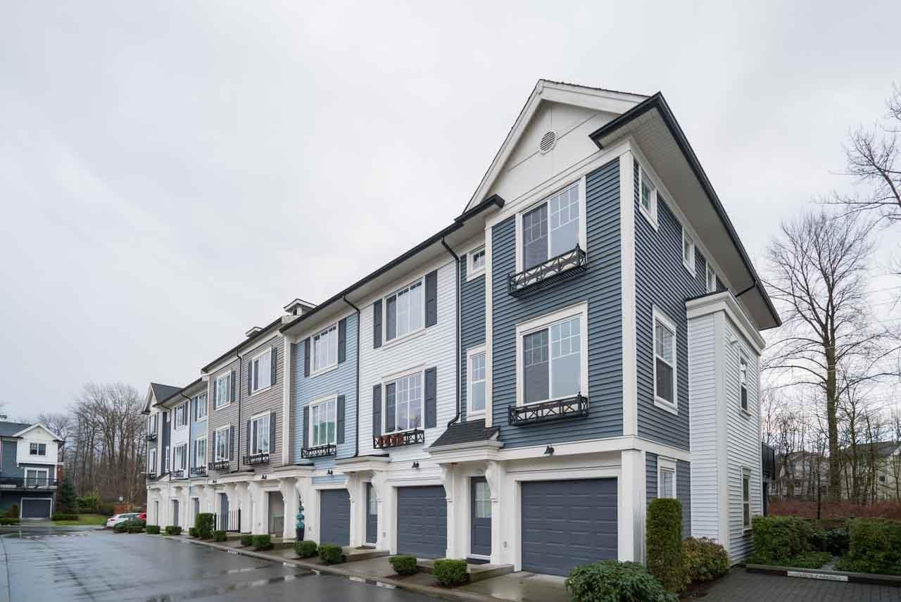 "Main Photo: 124 3010 RIVERBEND Drive in Coquitlam: Coquitlam East Townhouse for sale in ""WESTWOOD"" : MLS®# R2233937"