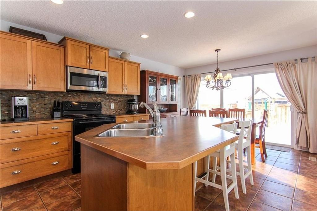 Photo 5: Photos: 944 CRANSTON Drive SE in Calgary: Cranston House for sale : MLS®# C4145156