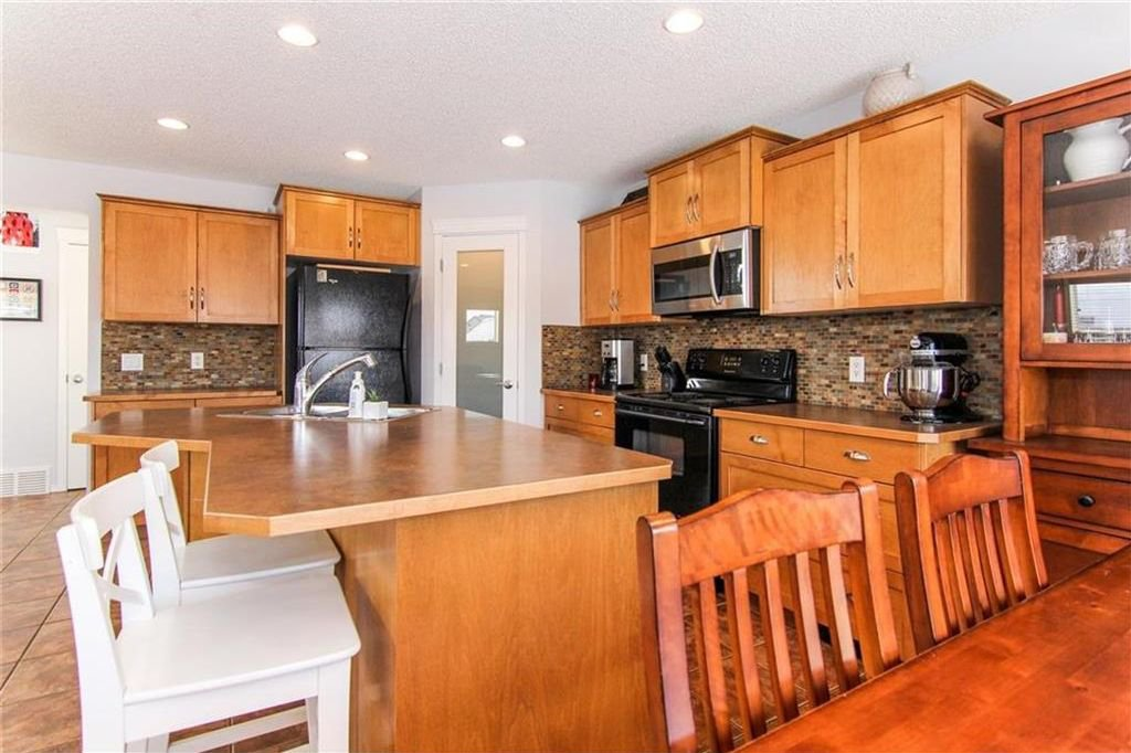 Photo 7: Photos: 944 CRANSTON Drive SE in Calgary: Cranston House for sale : MLS®# C4145156