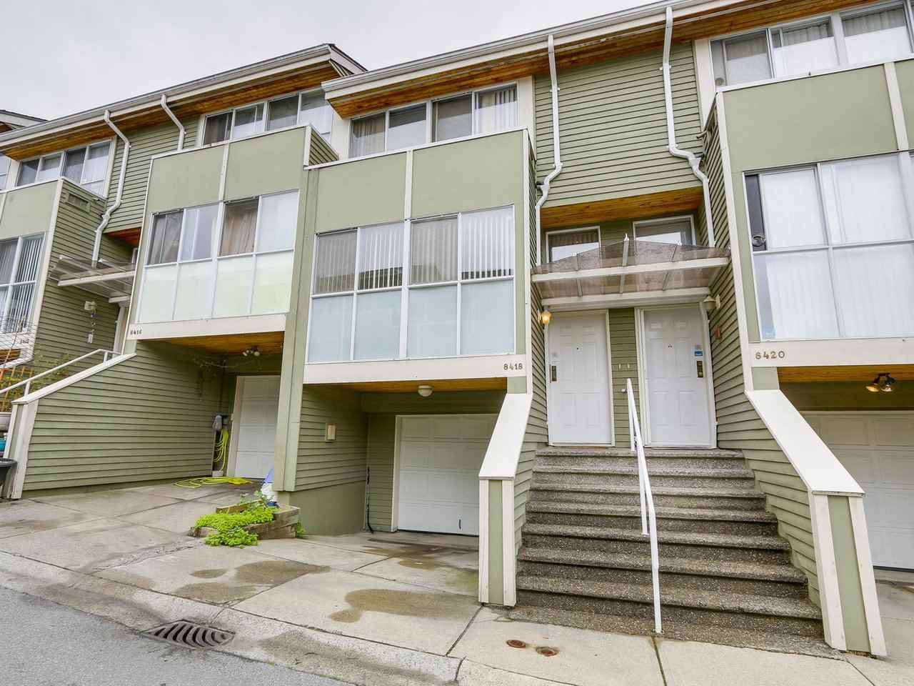 "Main Photo: 8418 CORNERSTONE Street in Vancouver: Champlain Heights Townhouse for sale in ""MARINE WOODS"" (Vancouver East)  : MLS®# R2209751"
