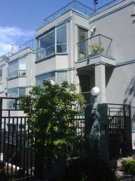 Main Photo: RAINSCREENED Fairview Townhouse!