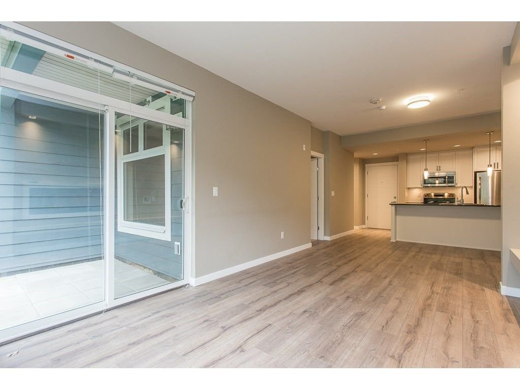 "Photo 3: Photos: 104 2238 WHATCOM Road in Abbotsford: Abbotsford East Condo for sale in ""Waterleaf"" : MLS®# R2260128"