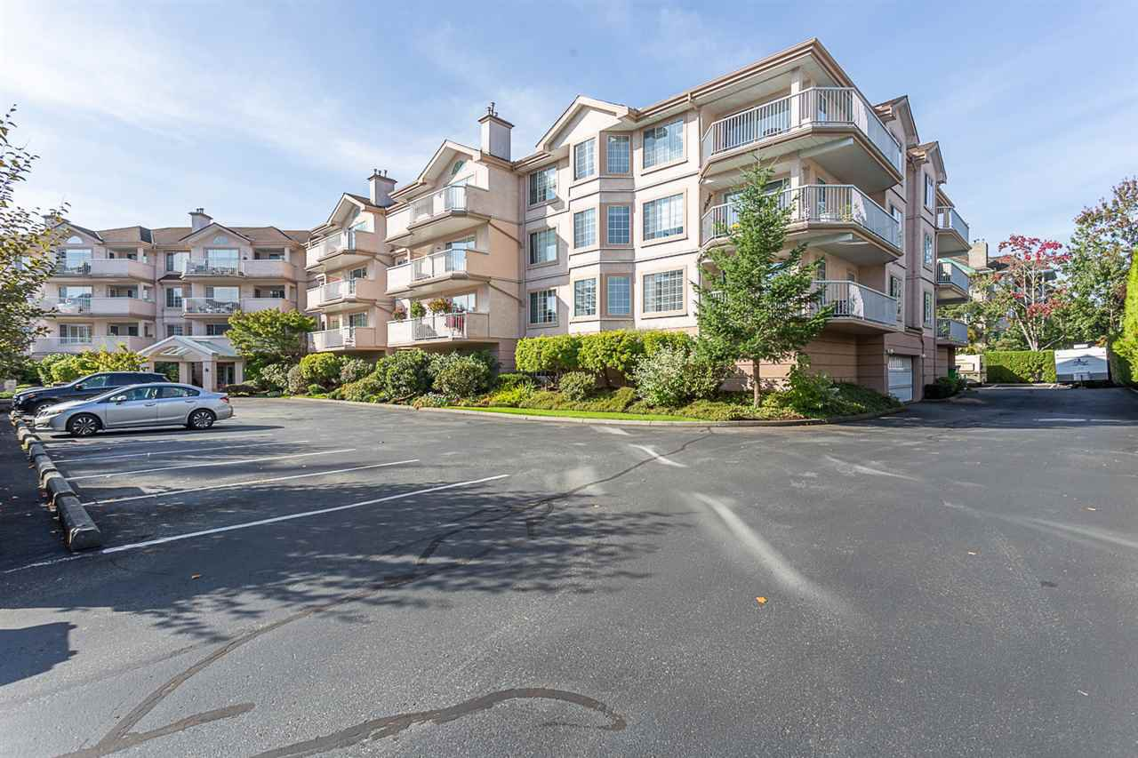 "Main Photo: 102 5375 205 Street in Langley: Langley City Condo for sale in ""GLENMONT PARK"" : MLS®# R2335377"