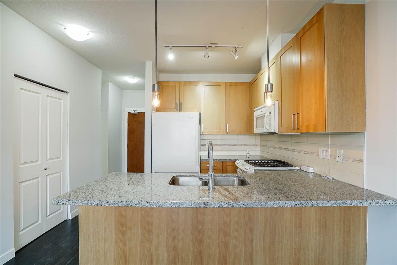 """Main Photo: 427 15918 26 Avenue in Surrey: Grandview Surrey Condo for sale in """"The Morgan"""" (South Surrey White Rock)  : MLS®# R2242399"""