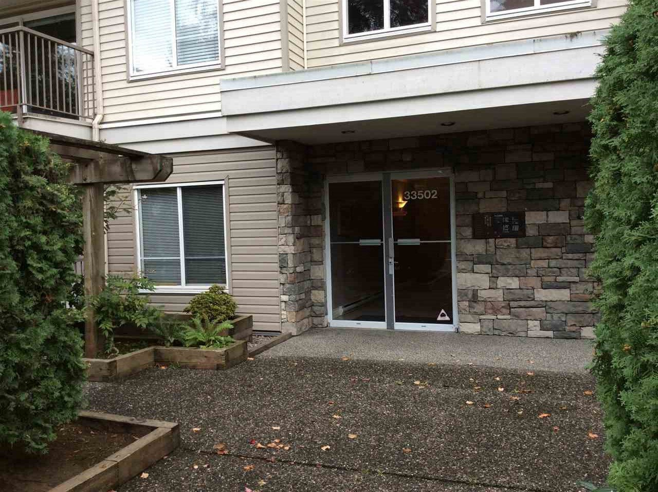 """Photo 2: Photos: 203 33502 GEORGE FERGUSON Way in Abbotsford: Central Abbotsford Condo for sale in """"Carina Crt"""" : MLS®# R2113543"""