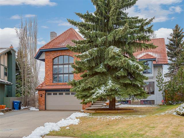 Main Photo: 424 COACH LIGHT Bay SW in Calgary: Coach Hill House for sale : MLS®# C4112862