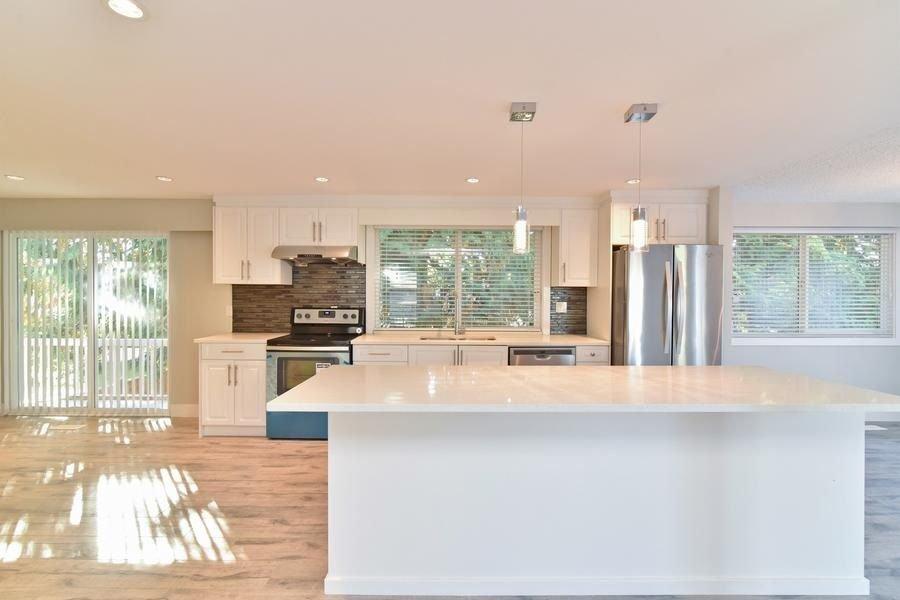 Main Photo: 9228 148 A Street in Surrey: Fleetwood Tynehead House for sale : MLS®# R2211815