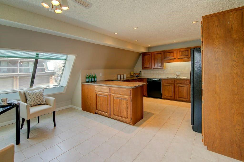 Photo 9: Photos: 42 700 RANCH ESTATES Place NW in Calgary: Ranchlands House for sale : MLS®# C4178885
