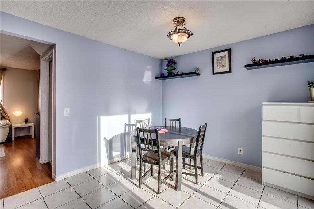 Photo 12: Photos: 111 ERIN RIDGE Road SE in Calgary: Erin Woods House for sale : MLS®# C4162823