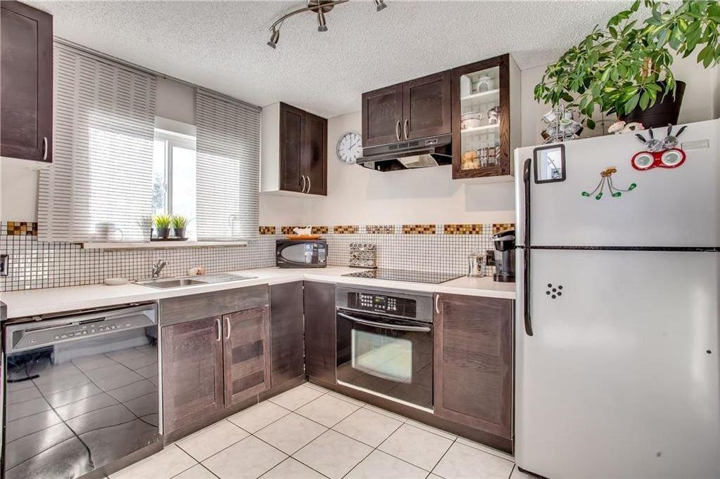 Photo 17: Photos: 111 ERIN RIDGE Road SE in Calgary: Erin Woods House for sale : MLS®# C4162823
