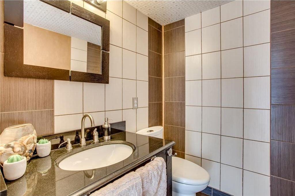 Photo 22: Photos: 111 ERIN RIDGE Road SE in Calgary: Erin Woods House for sale : MLS®# C4162823