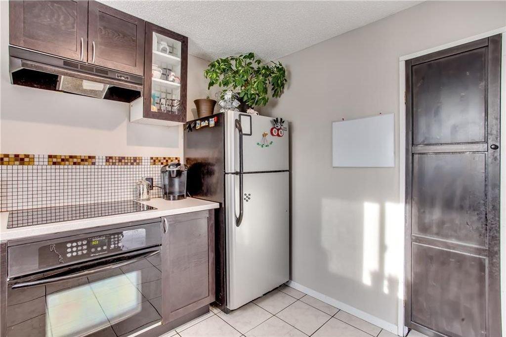 Photo 19: Photos: 111 ERIN RIDGE Road SE in Calgary: Erin Woods House for sale : MLS®# C4162823