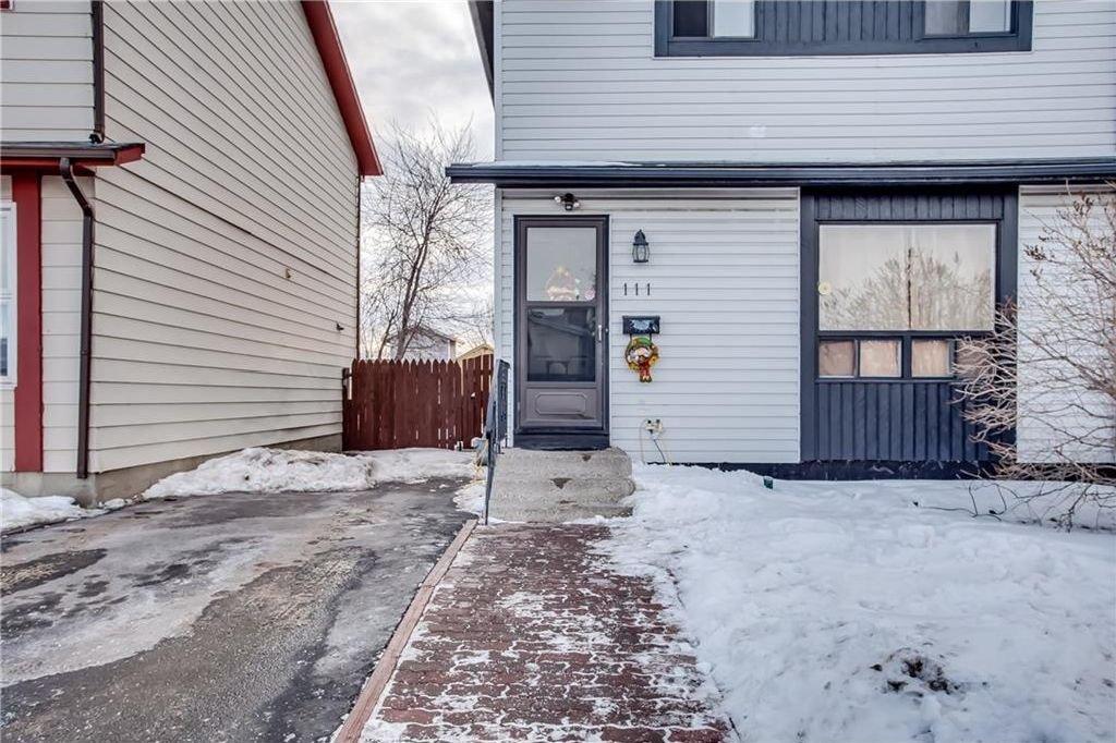Photo 5: Photos: 111 ERIN RIDGE Road SE in Calgary: Erin Woods House for sale : MLS®# C4162823