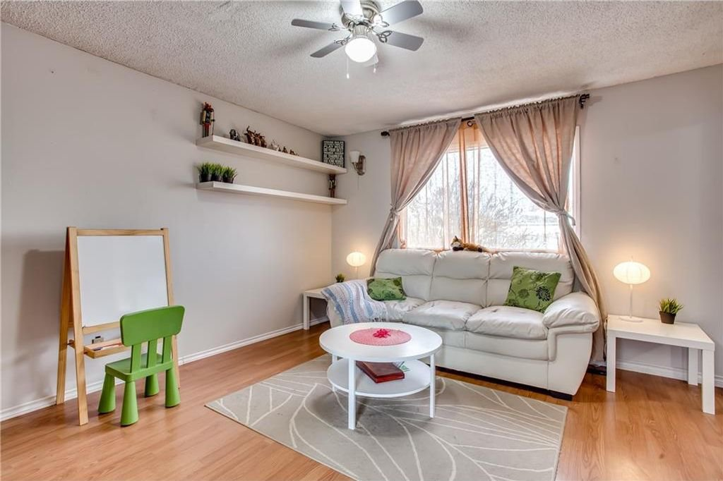 Photo 8: Photos: 111 ERIN RIDGE Road SE in Calgary: Erin Woods House for sale : MLS®# C4162823