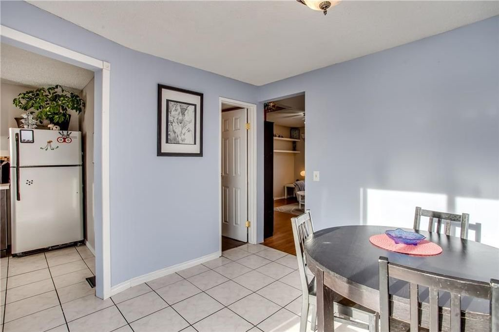 Photo 14: Photos: 111 ERIN RIDGE Road SE in Calgary: Erin Woods House for sale : MLS®# C4162823