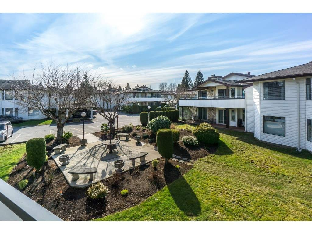 "Main Photo: 220 15153 98 Avenue in Surrey: Guildford Townhouse for sale in ""Glenwood Villiage"" (North Surrey)  : MLS®# R2246707"