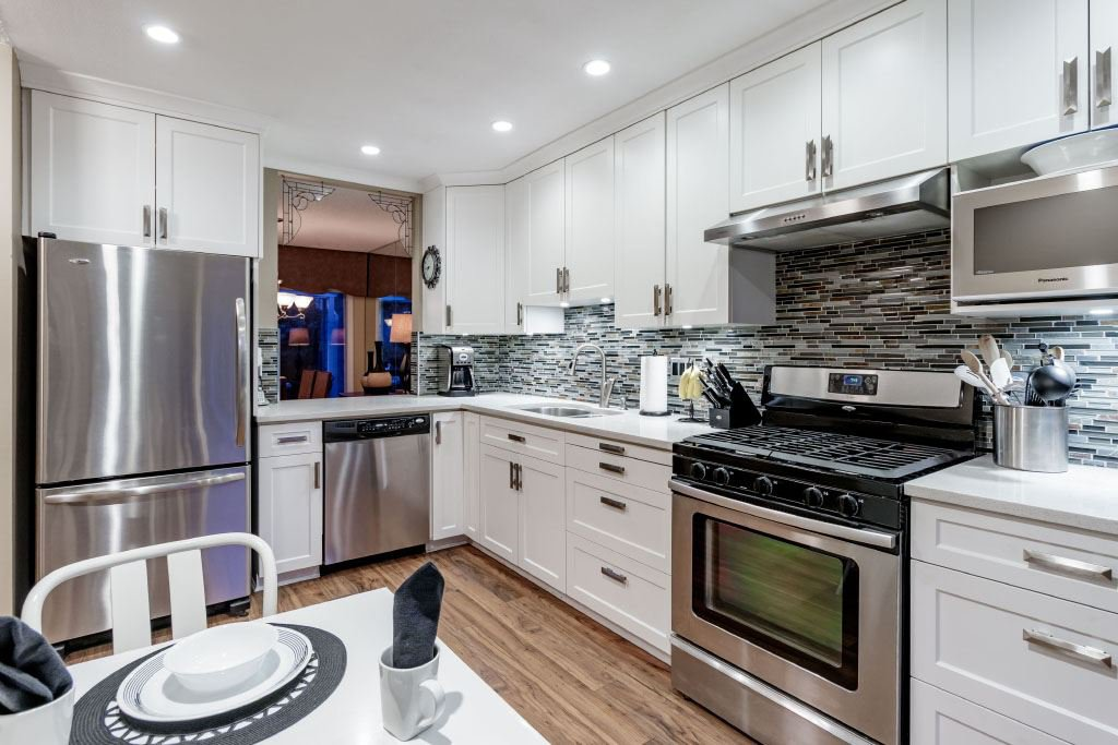 """Main Photo: 18 2590 AUSTIN Avenue in Coquitlam: Coquitlam East Townhouse for sale in """"AUSTIN WOODS"""" : MLS®# R2369041"""