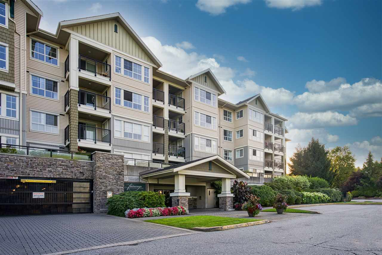 "Main Photo: 209 19673 MEADOW GARDENS Way in Pitt Meadows: North Meadows PI Condo for sale in ""The Fairways"" : MLS®# R2496711"