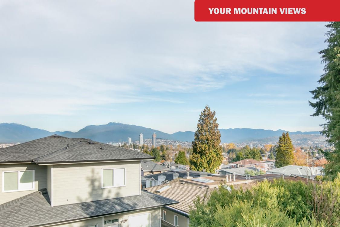 STUNNING MOUNTAIN VIEWS on main & upper floors