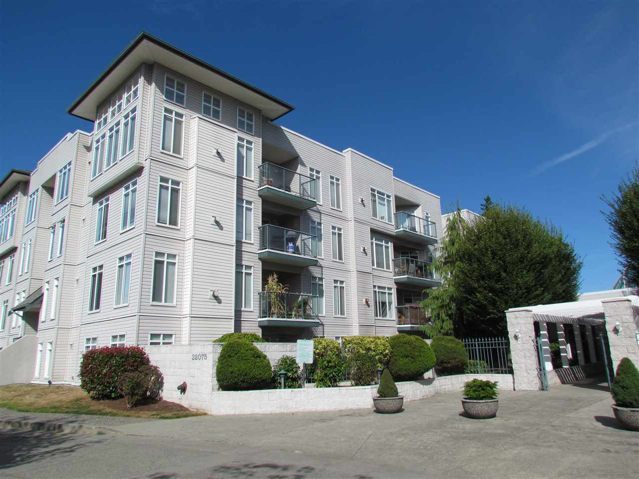 "Main Photo: 203 32075 GEORGE FERGUSON Way in Abbotsford: Abbotsford West Condo for sale in ""ARBOUR COURT"" : MLS®# R2290695"