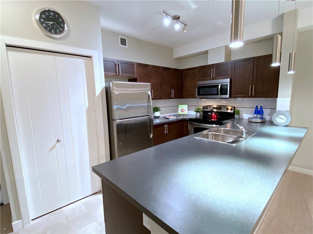 The unique layout of this 2 Bedroom condo allows for an extra large Kitchen...  This Breakfast Bar goes on for miles doesn't it?!