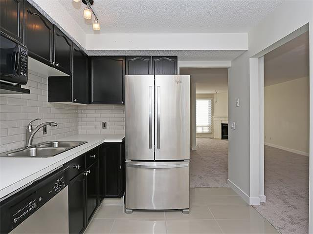 Photo 11: Photos: 208 COACHWAY Lane SW in Calgary: Coach Hill House for sale : MLS®# C4092510