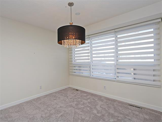 Photo 18: Photos: 208 COACHWAY Lane SW in Calgary: Coach Hill House for sale : MLS®# C4092510