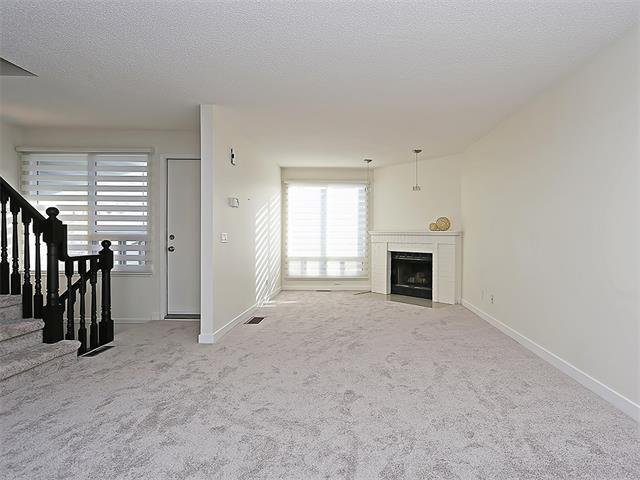 Photo 25: Photos: 208 COACHWAY Lane SW in Calgary: Coach Hill House for sale : MLS®# C4092510