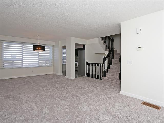 Photo 15: Photos: 208 COACHWAY Lane SW in Calgary: Coach Hill House for sale : MLS®# C4092510
